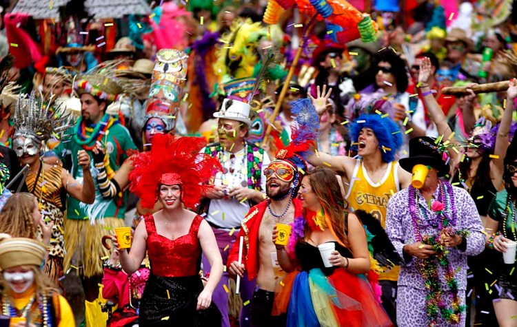 A marching group arrives at Canal Street as it marches ahead of the Krewe of Zulu on Mardi Gras Day in New Orleans, Tuesday, March 8, 2011.